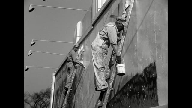ws painters painting over roadside billboard / united states - house painter stock videos and b-roll footage