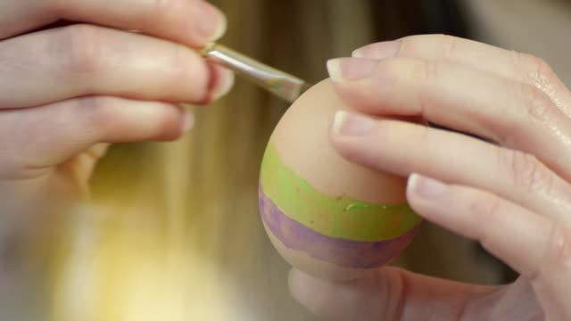 painting a purple stripe on an easter egg - painting activity stock videos & royalty-free footage