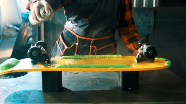 painting a skateboard 4k - craftsman stock videos and b-roll footage