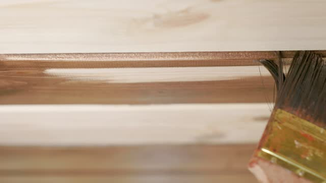 painting a wooden surface. close-up. - wood stain stock videos & royalty-free footage