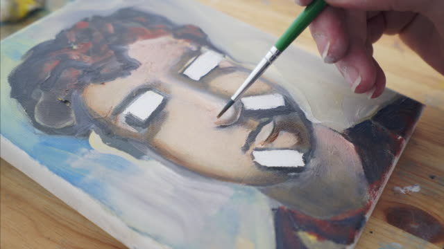 painting abstract self portrait. - art class stock videos & royalty-free footage