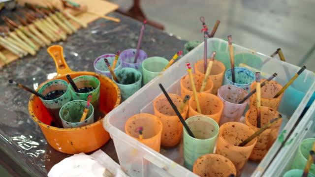 painting accessories in batik workshop - batik stock videos and b-roll footage