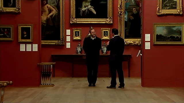 dulwich picture gallery 'fake' exhibition; england: london: dulwich picture gallery: reporter asking nicholas eastaugh to find the replica painting... - dulwich stock videos & royalty-free footage
