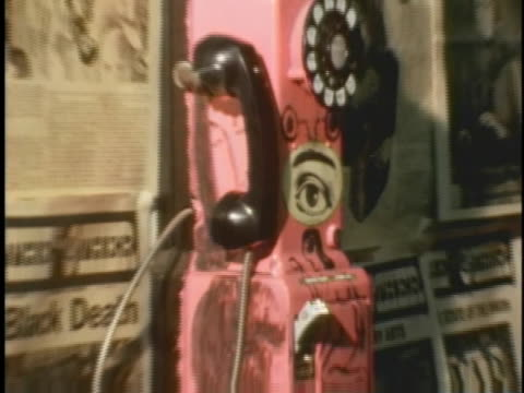 painting featuring an eye peering through a hole adorns a public telephone in new york's east village. - psychedelic stock videos & royalty-free footage