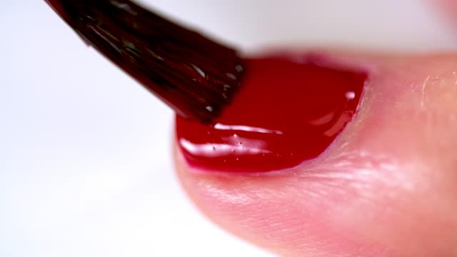 cu painting fingernails red - femininity stock videos & royalty-free footage