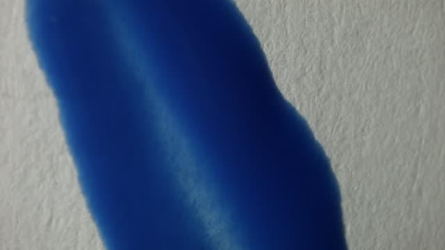vídeos y material grabado en eventos de stock de painting in a paper with blue 2 - pincel