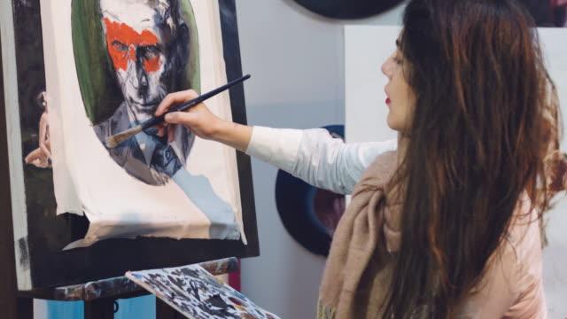 Painting in her studio