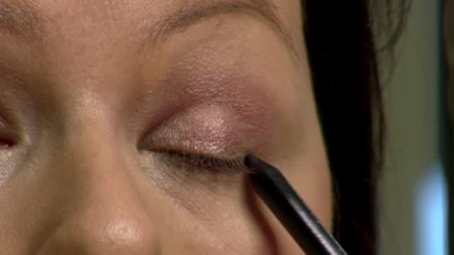 painting line on eyelid - eyebrow stock videos & royalty-free footage