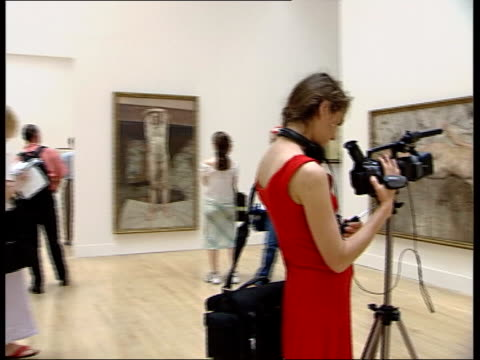 lucien freud retrospective; freud self-portrait painting on display painting 'the painter's room' woman looking at painting freud portraits of women... - pen and ink stock videos & royalty-free footage