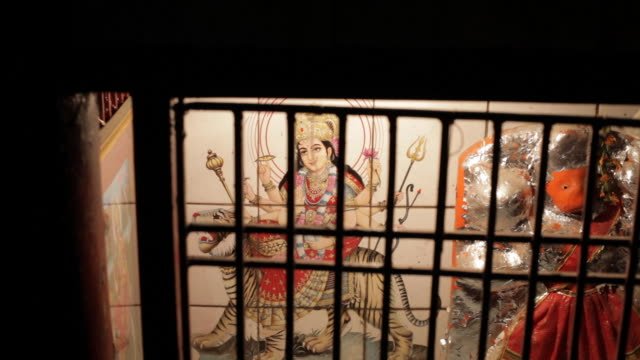 ms painting of hindu god behind window grill / india - god's window stock videos and b-roll footage
