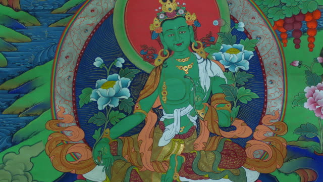 vidéos et rushes de a painting of the tara buddha in a temple, tibet - temple