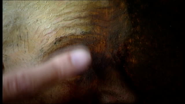 picture restorer discovers 'hidden' rembrandt; music overlay: j.s. bach - goldberg variations : martin bijl works on rembrandt portrait of old woman... - scalpel stock videos & royalty-free footage