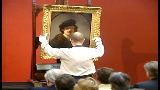 picture restorer discovers 'hidden' rembrandt tx england london sotheby's rembrandt selfportrait is displayed in front of sotheby's auction audience... - sotheby's stock videos and b-roll footage