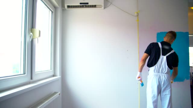painting the wall - professional painter stock videos and b-roll footage
