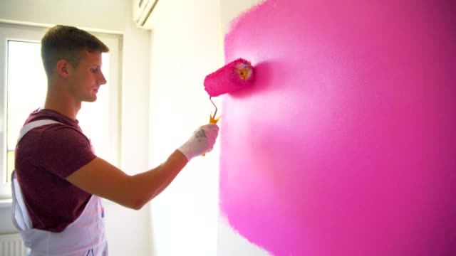 painting the wall - paint roller stock videos & royalty-free footage