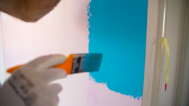 painting the wall - house painter stock videos and b-roll footage