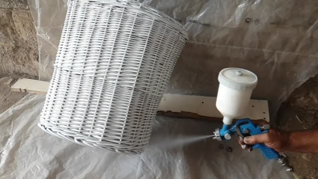painting the wooden basket with a gun - airbrush stock videos & royalty-free footage