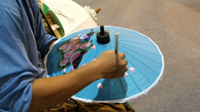 painting umbrella,thailand - drawing artistic product stock videos and b-roll footage