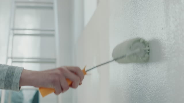 painting wall with paint roller - paint roller stock videos & royalty-free footage