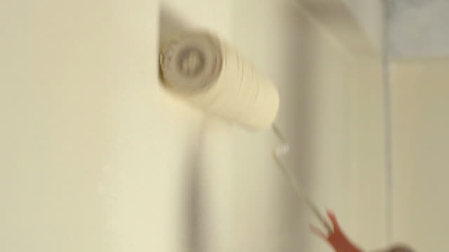 slo mo painting wall with paintbrush - paint roller stock videos & royalty-free footage