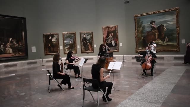 paintings are displayed behind a string quintet performing 'ode to joy' as the prado museum opens again to the public on june 06, 2020 in madrid,... - five people stock videos & royalty-free footage
