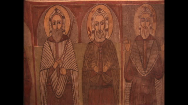 paintings of saints cover the walls of st. antony's monastery. - heiliger stock-videos und b-roll-filmmaterial