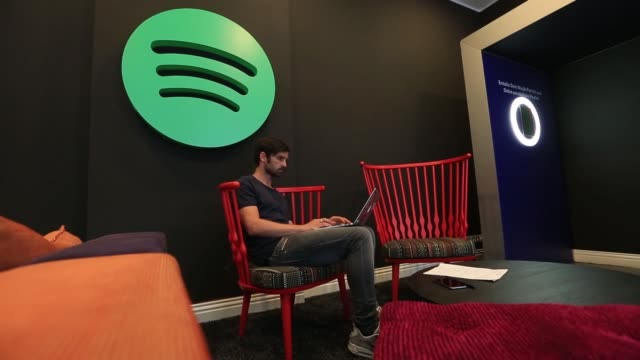 a pair of audio headphones hang from a lamp shade inside the offices music streaming company spotify ltd in berlin germany on friday june 17 a... - lamp shade stock videos & royalty-free footage