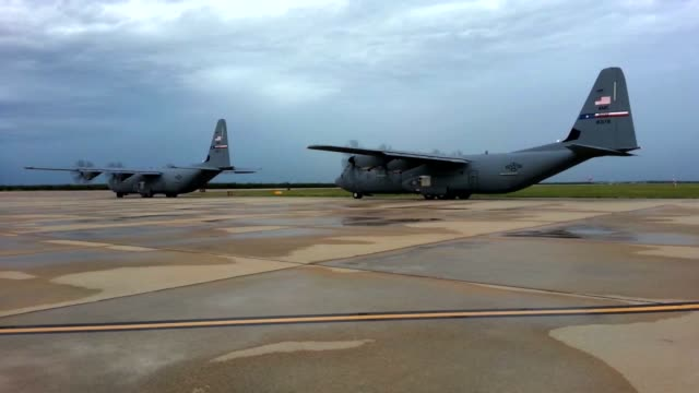 A pair of C130 Hercules transport cargo aircraft taxi for take off at Dyess AFB