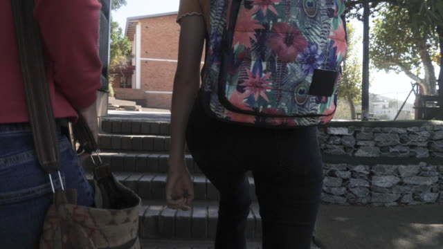 pair of college girls walk to class, slow motion - rucksack stock videos & royalty-free footage