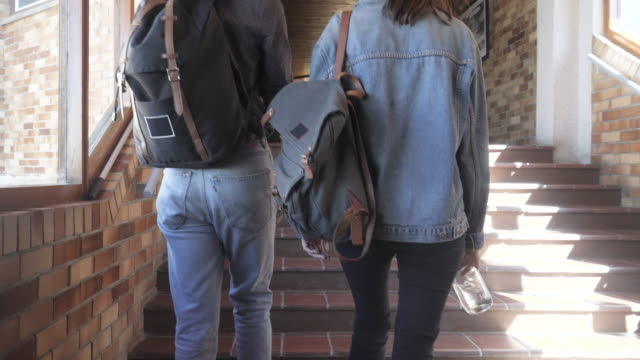 pair of college students walk to class in slow motion - boyfriend stock videos & royalty-free footage