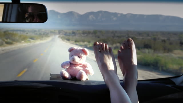ms pov pair of female toes winking and moving in car / palmdale, ca, united states      - toe stock videos & royalty-free footage