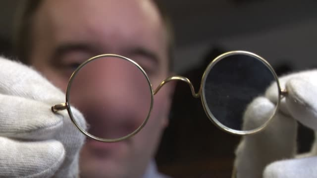 pair of glasses thought to have belonged to indian independence leader mahatma gandhi are up for sale after having been stuffed through an auction... - letterbox stock-videos und b-roll-filmmaterial