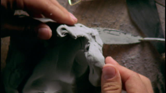 a pair of hands shape a hunk of clay. - sculpture stock videos & royalty-free footage