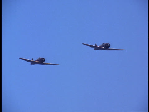 a pair of japanese zeros flying by. - pearl harbor stock videos and b-roll footage