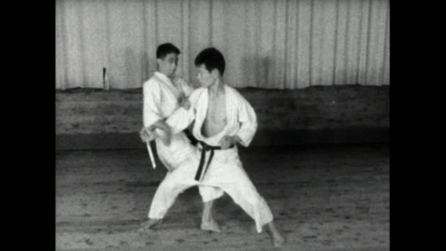 pair of karate students spar with knife in tokyo dojo; 1959 - 1959 stock videos & royalty-free footage