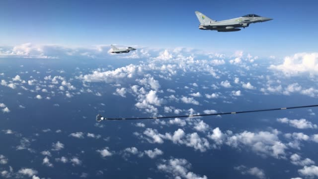 pair of raf typhoon combat aircraft prepare to refuel from an raf voyager aircraft over the north sea on october 08, 2020 in flight, above scotland.... - refuelling stock videos & royalty-free footage
