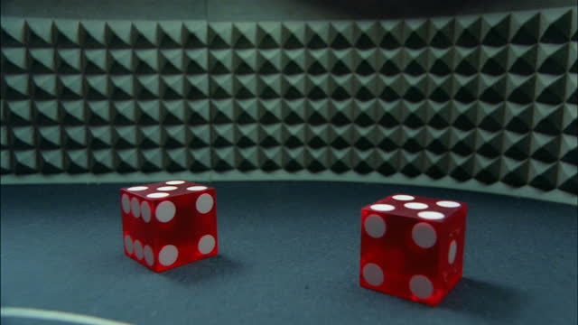 a pair of red dice roll and land with a pair of fives showing. - luck stock videos & royalty-free footage