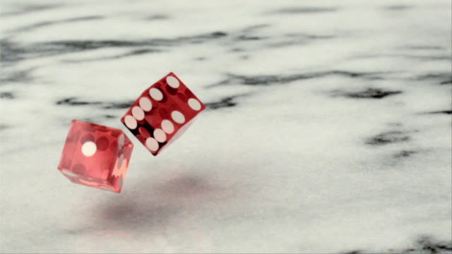 CU SLO MO Pair of red dice rolling on marble / San Francisco, California, USA