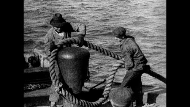 pair of steam whistles gang planks extended to ship luggage conveyor men lifting docking rope ws people waving from ship to dock ws steamer passenger... - 1934 stock-videos und b-roll-filmmaterial