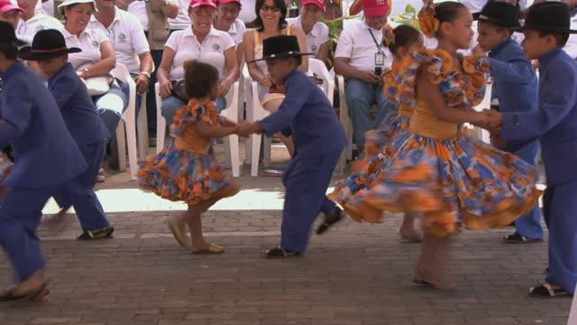 PAN Pairs of Hispanic girls and boys dancing to traditional Spanish music / Bogata, Columbia