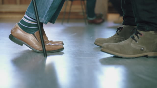 pairs of men chatting in men's therapy session - feet only - sock stock videos & royalty-free footage