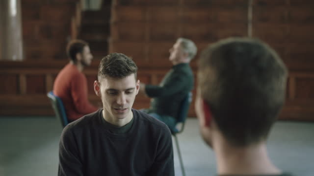 Pairs of men chatting in men's therapy session