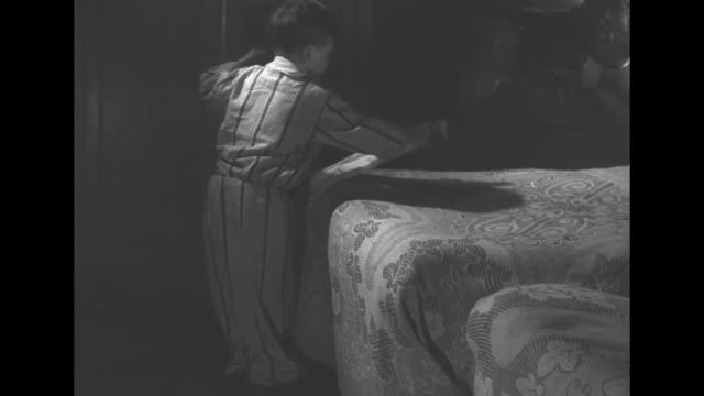 vs a pajamaclad little boy in dim light places four long stockings at the base of two beds / he snuggles into bed and lays his head on the pillow his... - pyjamas stock videos & royalty-free footage
