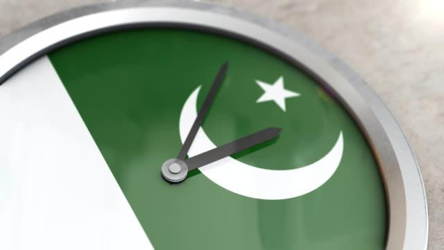 pakistan flag clock timelapse - pakistan stock videos & royalty-free footage