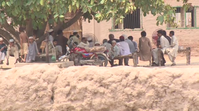 pakistan police arrest four more men involved in the rape of a teenage girl as punishment for a rape committed by her brother - multan stock videos and b-roll footage