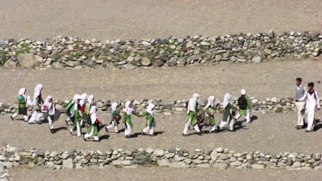 pakistan: pupils walking to school - pakistan stock videos & royalty-free footage