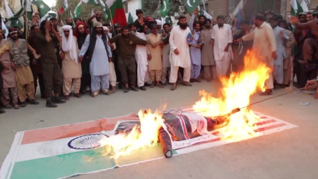 pakistani demonstrators burn an effigy of us president donald trump over an indian and us flag during a protest in quetta - pakistani flag stock videos and b-roll footage
