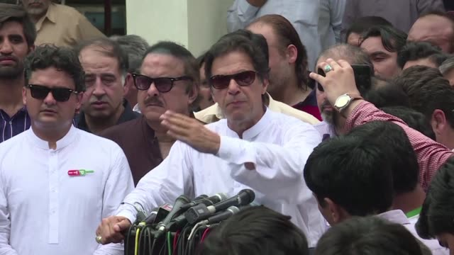 pakistani election hopeful and former world cup cricketer imran khan casts his vote in the country's general election - früherer stock-videos und b-roll-filmmaterial