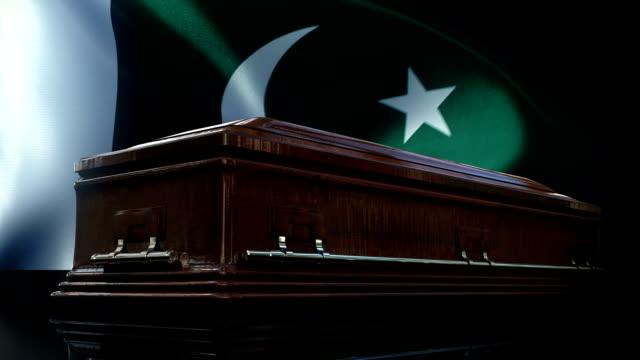 pakistani flag behind coffin - pakistani flag stock videos & royalty-free footage