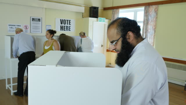 4k: pakistani man voting at booth at polling station. elections - voting booth stock videos and b-roll footage